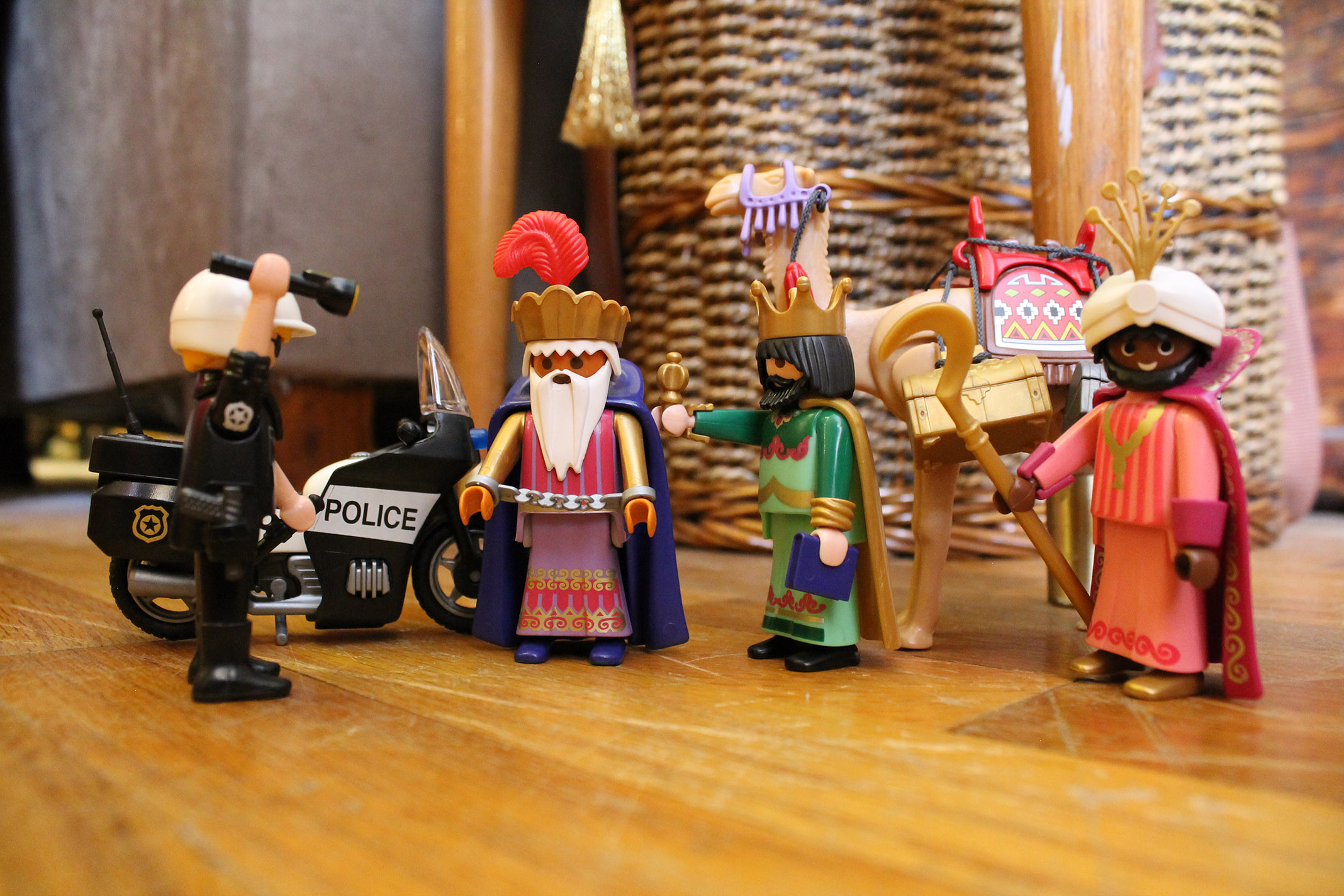 The three wisemen. Balthazar is getting arrested for driving the camel too fast.