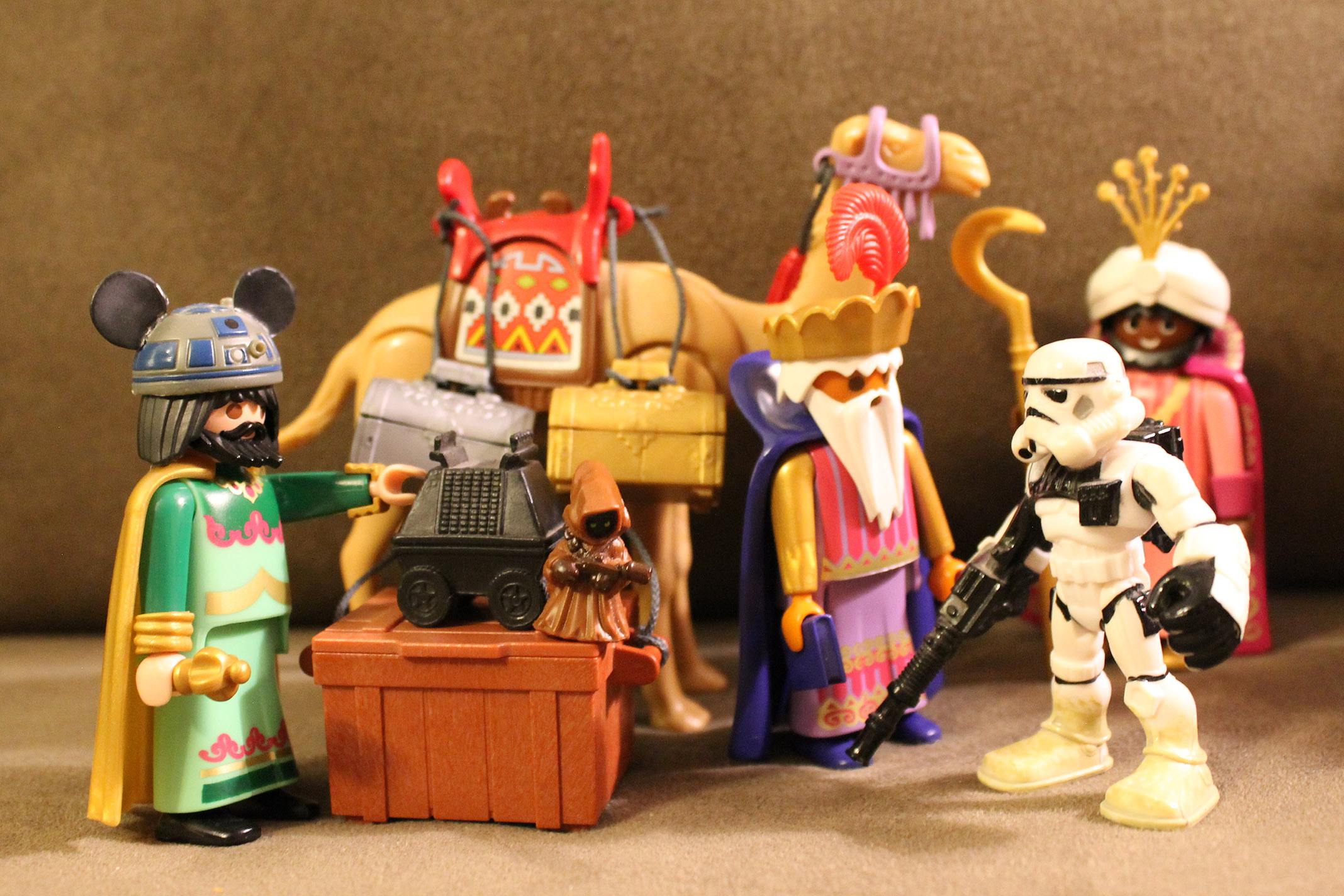 Three wisemen and a Sandtrooper with a Jawa.