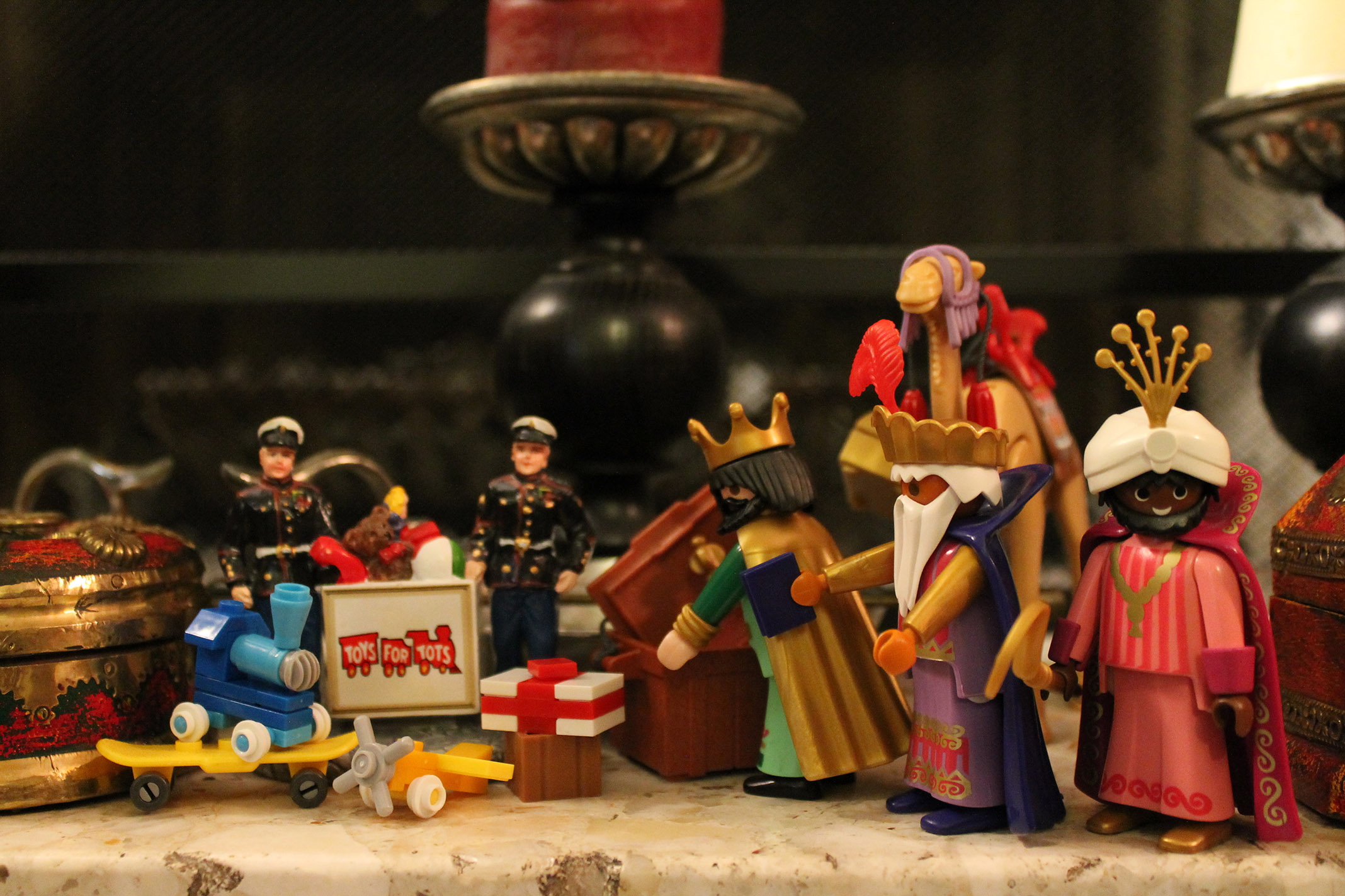 The wisemen give to Toys for Tots.