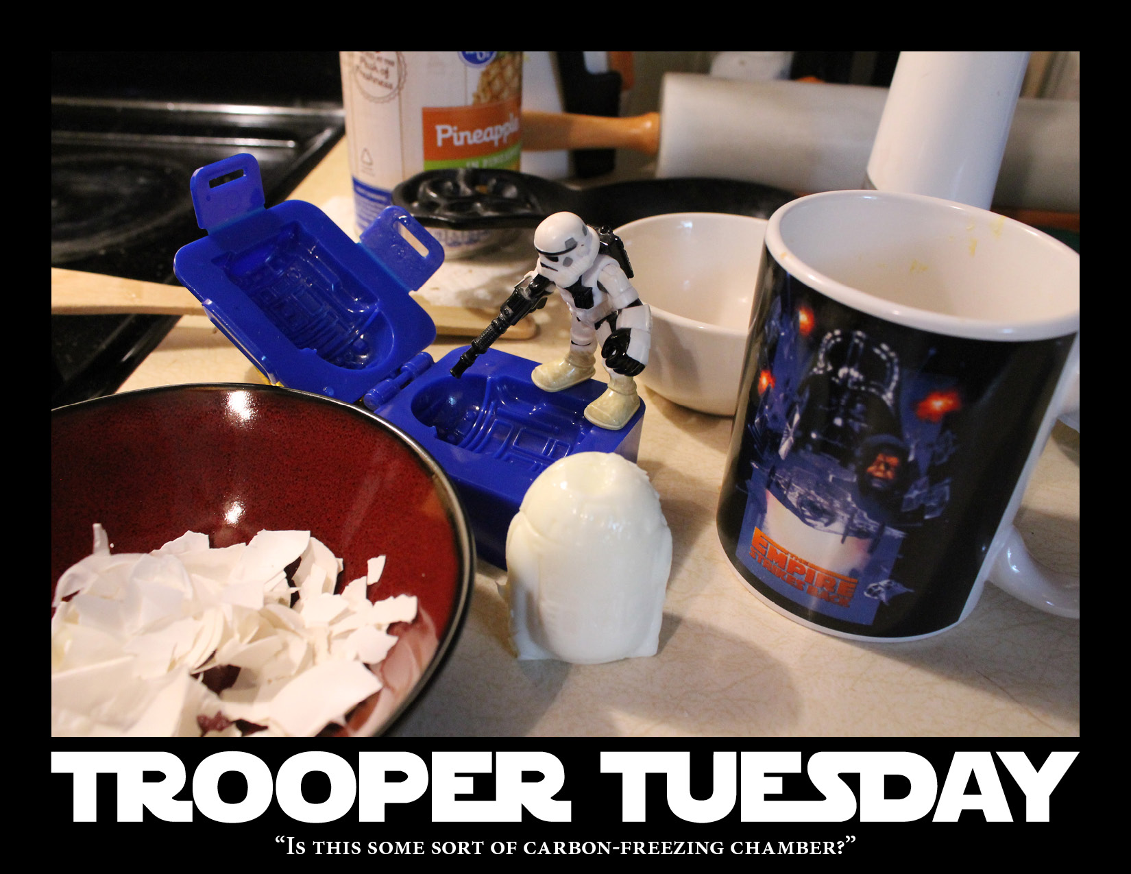 Stormtrooper examines an egg mold shaped like R2-D2.