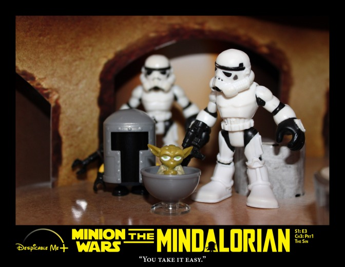 Two Stormtroopers escort the Mindalorian and baby Yoda.