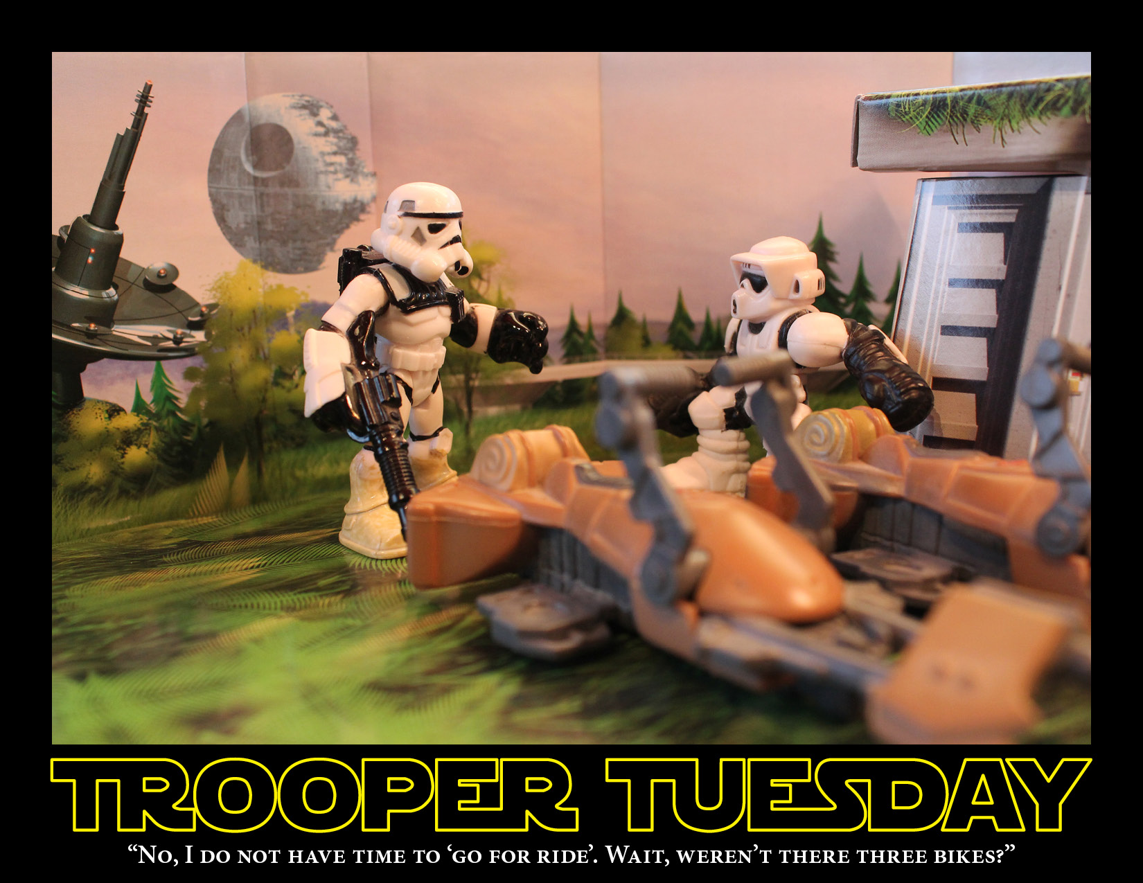 A Sandtrooper and Biker Scout stand near two speeder bikes, on Endor's moon.