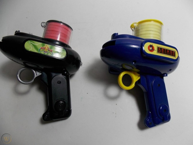 photo of 1994 Power Rangers and Batman animated series foam-disk shooters.