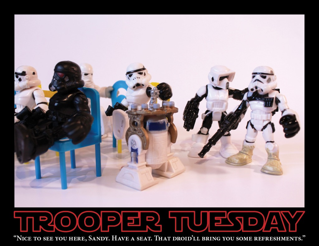 Stormtroopers gather together in a support meeting. R2-D2 serves refreshments.