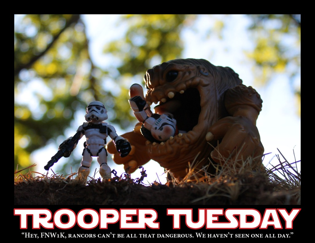 A Sandtrooper is eaten by a rancor while another Sandtrooper stands unawares.